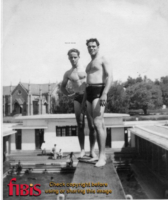 Derrick Cartner and unknown man on diving board