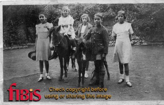 Five children with two ponies