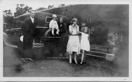 Cartner family next to a car