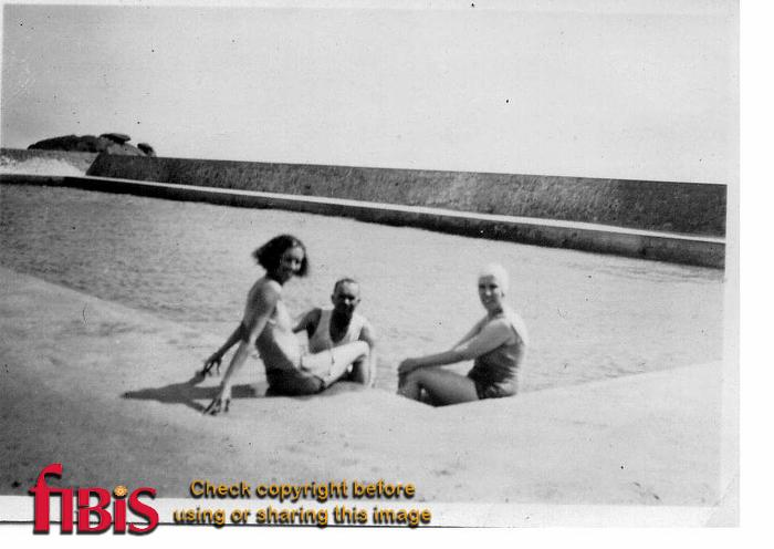 two ladies and a man swimming