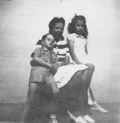 Unknown woman and two children