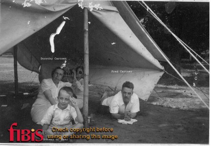 Dorothy, Fred and Michael Cartner in a tent